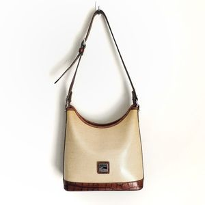 Dooney and Bourke leather trim crossbody bag